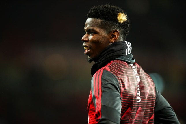 Paul Pogba grins as he warms up for Manchester United before a game