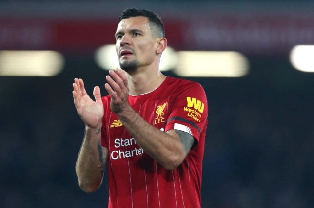 Dejan Lovren applauds Liverpool fans after a win
