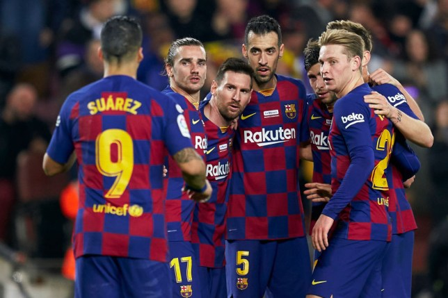 Lionel Messi is congratulated by his Barcelona team-mates after scoring a goal
