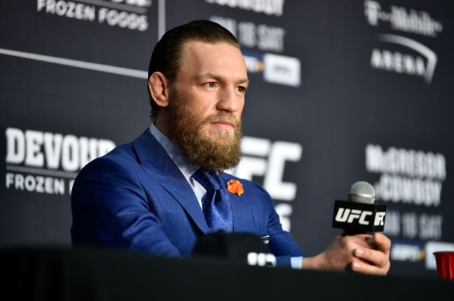 Conor McGregor listens to media after a UFC fight