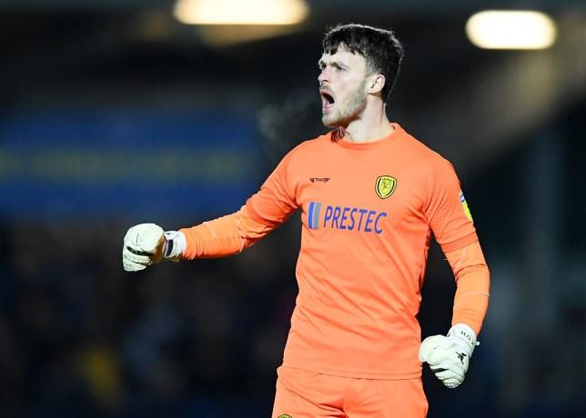 Man Utd goalkeeper Kieran O'Hara in action for Burton Albion