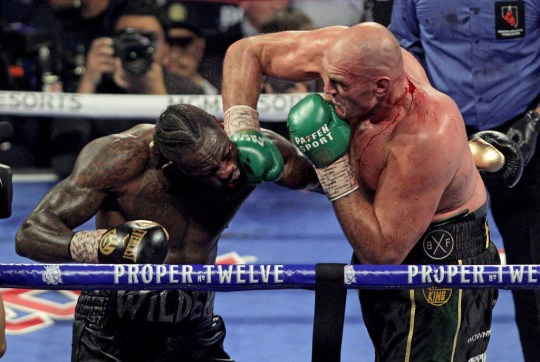 British boxer Tyson Fury slams a right to the head of US boxer Deontay Wilder during their WBC title fight