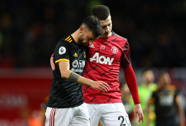 Diogo Dalot and Bruno Fernandes interact after a Manchester United game