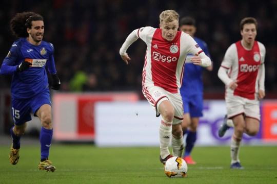 Donny van de Beek races past Marc Cucurella Cucu during an Ajax game