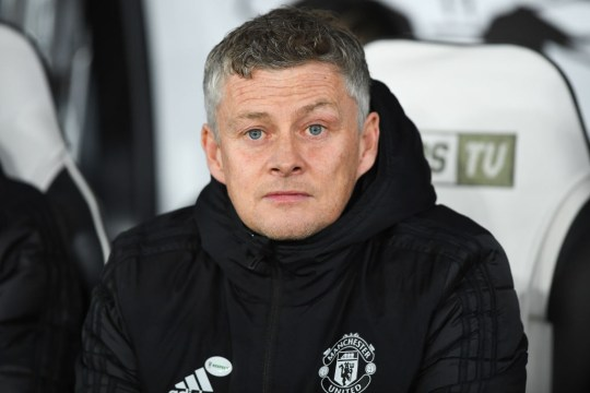 Ole Gunnar Solskjaer is pictured sitting on the Manchester United bench