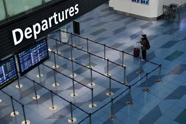 Passenger at an empty airport departure gate