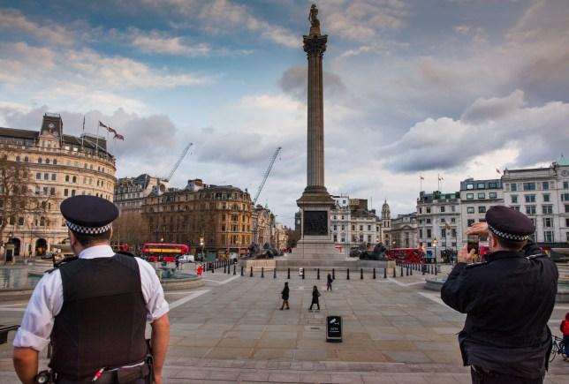 Police Patrolling a deserted Trafalgar Square as the Coronovirus clampdown began.