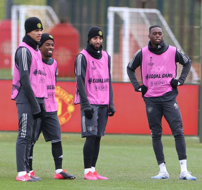 Bruno Fernanes and Aaron Wan-Bissaka look on during Manchester United training