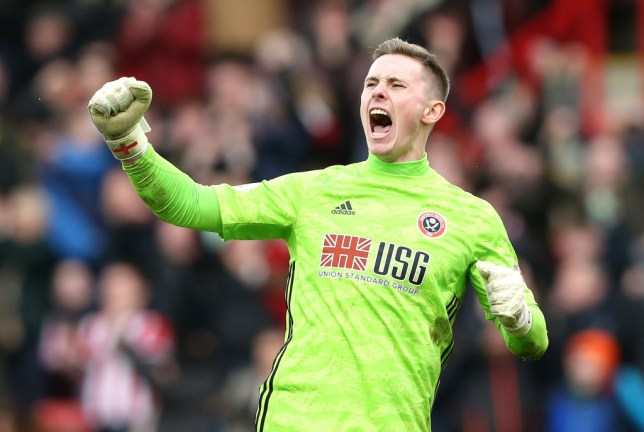 Manchester United goalkeeper Dean Henderson celebrates a win for Sheffield United