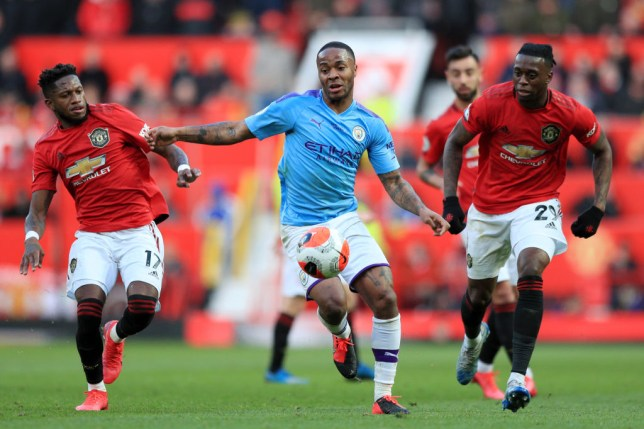 MANCHESTER, ENGLAND - MARCH 08: Fred of Manchester United and Aaron Wan-Bissaka of Manchester United battles for possession with Raheem Sterling of Manchester City  during the Premier League match between Manchester United and Manchester City at Old Trafford on March 08, 2020 in Manchester, United Kingdom. (Photo by Matt McNulty - Manchester City/Manchester City FC via Getty Images)