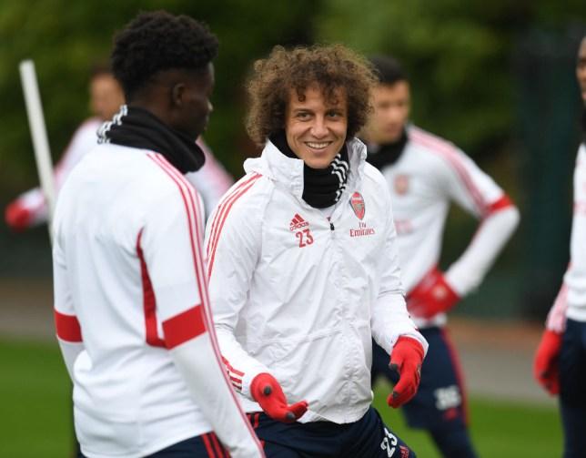 David Luiz smiles during Arsenal training