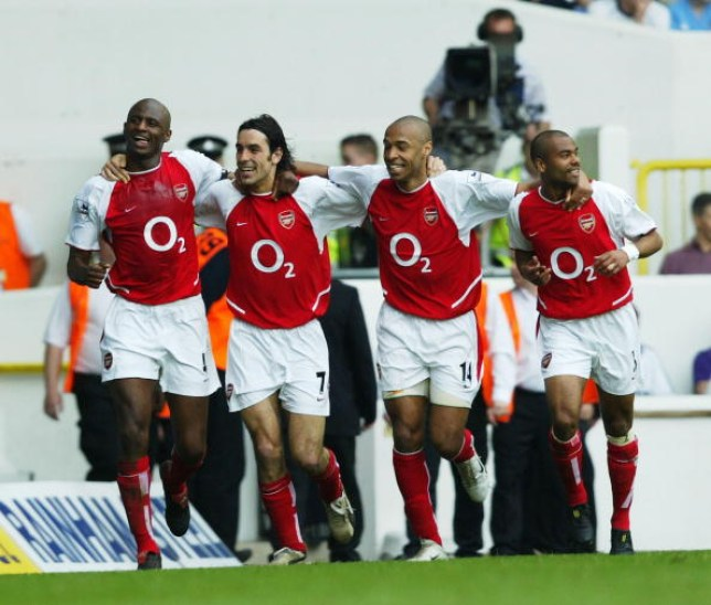 Patrick Vieira, Robert Pires, Thierry Henry and Ashley Cole of Arsenal celebrate after the second goal during the FA Barclaycard Premiership match between Tottenham Hotspur and Arsenal at White Hart Lane