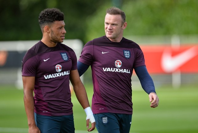 Alex Oxlade-Chamberlain and Wayne Rooney during a training session with England