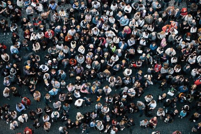 a crowd of people in a city