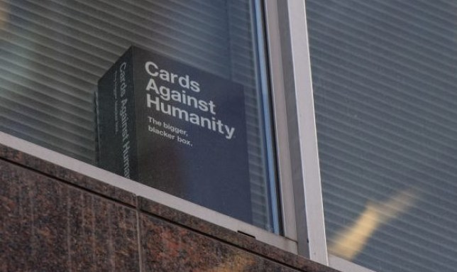 Card against humanity box in a window