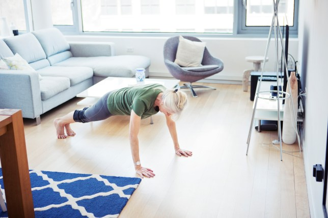 Woman doing plank at home