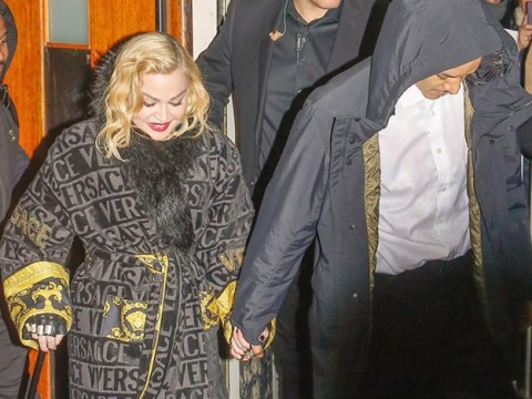 Madonna holds hands with boyfriend Ahlamalik Williams after 'crying on stage following fall'