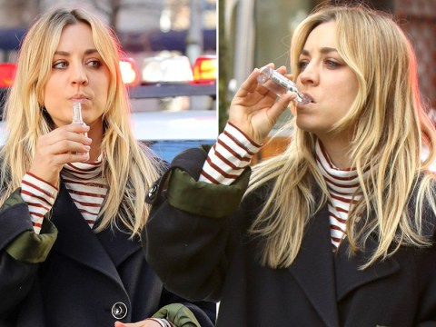 Kaley Cuoco sips miniature bottle of vodka in the middle of a crime scene on set of The Flight Attendant