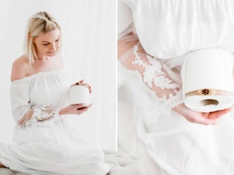 Photographer mocks coronavirus panic-buying by posing for newborn photoshoot with precious toilet roll