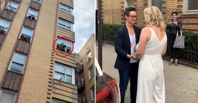 couple getting married on street with officiant shouting from window