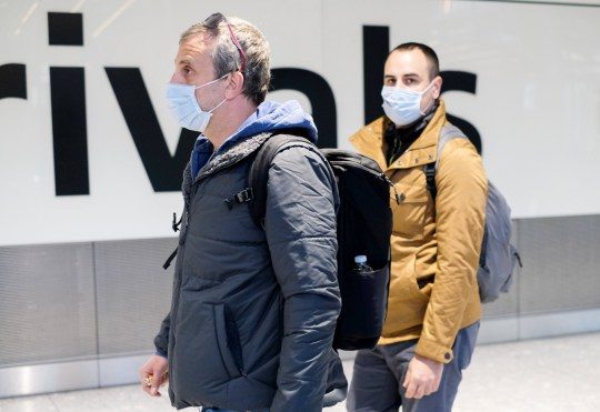 People arriving at Heathrow airport terminal 5 wearing facemasks due to the outbreak of coronavirus, Heathrow, London. 29th January 2020. British Airways has suspended all direct flights to and from mainland China because of the coronavirus outbreak, the airline has said. It comes after the UK Foreign Office advised against all but essential travel to the country. The virus has caused more than 100 deaths, spreading across China and to at least 16 other countries. Hundreds of foreign nationals have been evacuated from the city of Wuhan, the centre of the outbreak.