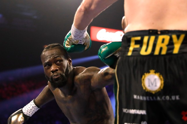 Deontay Wilder misses his punch against Tyson Fury