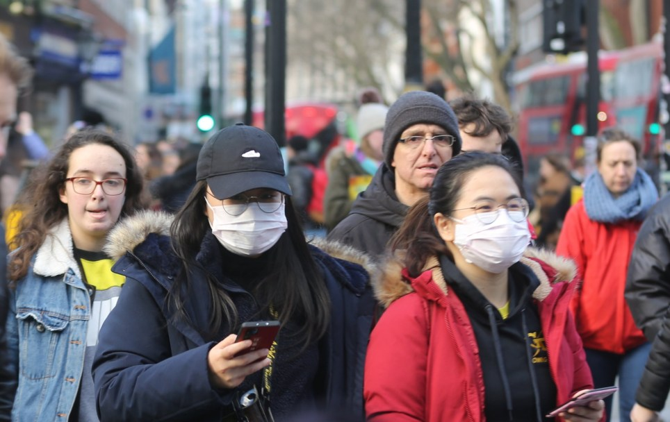 LONDON, UNITED KINGDOM - MARCH 01: People wear medical masks on the streets of London, England on March 01, 2020. Twelve more patients in England have tested positive for coronavirus, taking the total number of UK cases to 35. (Photo by Ilyas Tayfun Salci/Anadolu Agency via Getty Images)