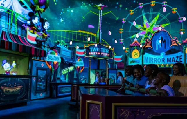 Guests visit an action-packed carnival as part of their journey aboard Mickey & Minnie???s Runaway Railway, opening March 4, 2020, in Disney???s Hollywood Studios at Walt Disney World Resort in Lake Buena Vista, Fla. The first ride-through attraction in Disney history featuring Mickey Mouse and Minnie Mouse brings guests into the vibrant world of ???Mickey Mouse??? cartoon shorts. (Matt Stroshane, photographer)