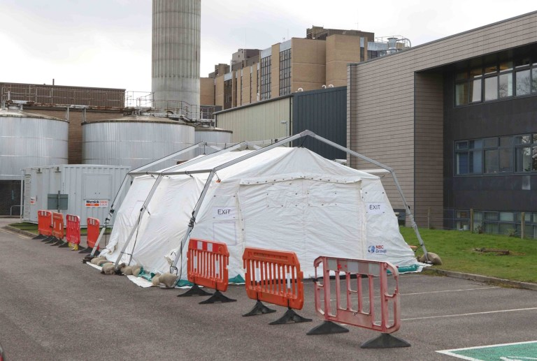 Mandatory Credit: Photo by Andrew Smith/REX (10573198e) A tent has been constructed behind Raigmore Hospital in Inverness, believed to be used for testing suspected cases of coronavirus. It is understood that people who contact NHS24 with concerns that they may have contracted the virus, are directed to drive in to the tent where they are tested inside their vehicle. Coronavirus outbreak, UK - 03 Mar 2020