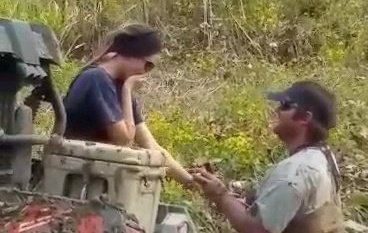 Video grab of the adorable moment that Ashton Waters, 29, proposed to his girlfriend Brittany, 27, while she was stuck knee deep in MUD