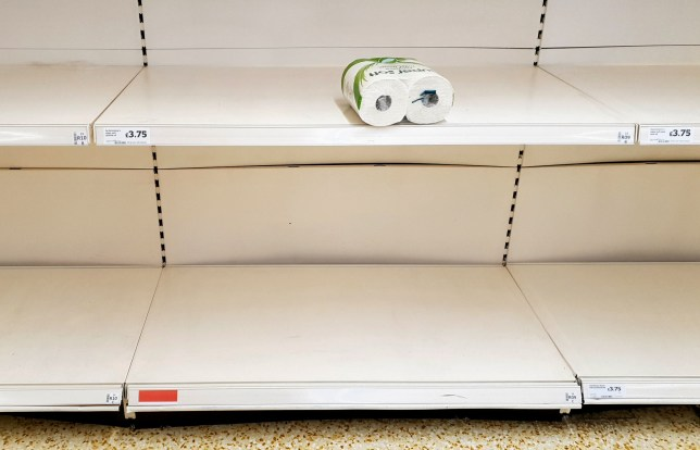 A view of empty shelves as toilet roll is almost sold out in a supermarket in Ashford