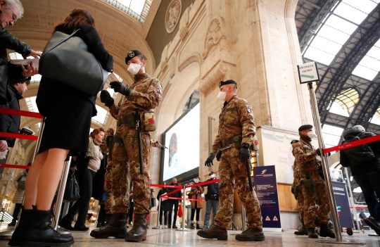 Police officers and soldiers check passengers leaving from Milan main train station, Italy, Monday, March 9, 2020. Italy took a page from China's playbook Sunday, attempting to lock down 16 million people ??? more than a quarter of its population ??? for nearly a month to halt the relentless march of the new coronavirus across Europe. Italian Premier Giuseppe Conte signed a quarantine decree early Sunday for the country's prosperous north. Areas under lockdown include Milan, Italy's financial hub and the main city in Lombardy, and Venice, the main city in the neighboring Veneto region. (AP Photo/Antonio Calanni)