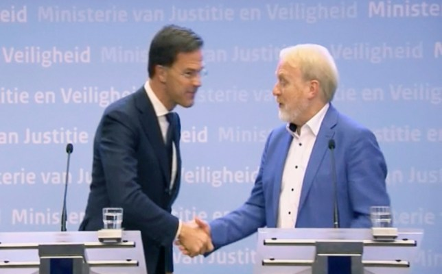In this grab taken from video provided by RTL Netherlands, Netherlands' Prime Minister Mark, left, shakes hands with Head of Infectious Diseases, Jaap van Dissel of the Public Health Institute, at The Hague, Netherlands, Tuesday, March 10, 2020. Rutte called on citizens of the Netherlands to stop shaking hands to prevent spreading the new coronavirus and then shook hands with the head of the infectious diseases department of the national public health institute. (RTL Netherlands via AP)