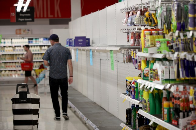 AAP via PA Images. Empty toilet paper shelves at Coles supermarket in Adelaide, Friday, March 13, 2020. (AAP Image/Kelly Barnes) NO ARCHIVING ** STRICTLY EDITORIAL USE ONLY **