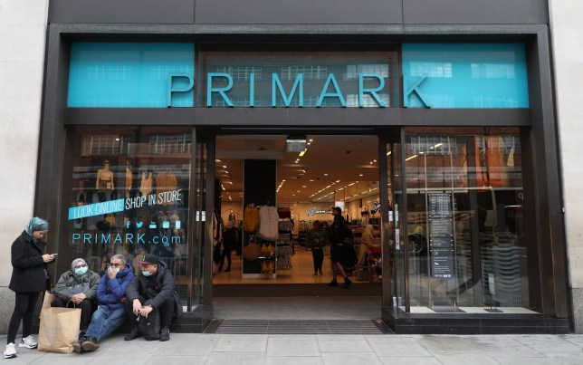 People in masks outside a Primark in Oxford Street in London, as the Government's top scientist warned that up to 10,000 people in the UK are already infected with Covid-19. PA Photo. Picture date: Friday March 13, 2020. See PA story HEALTH Coronavirus. Photo credit should read: Yui Mok/PA Wire