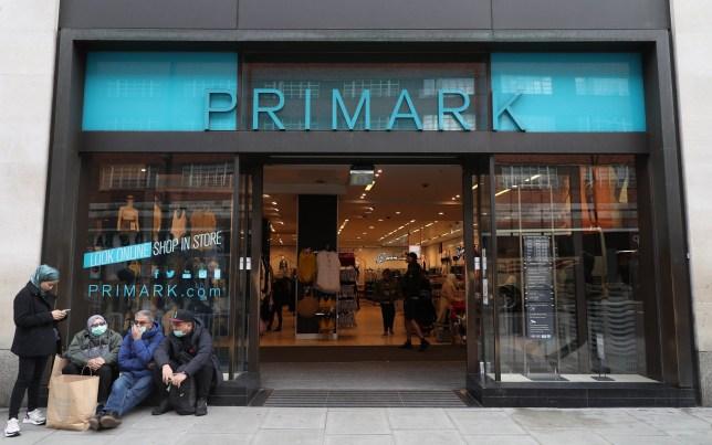 People in masks outside a Primark in Oxford Street in London,