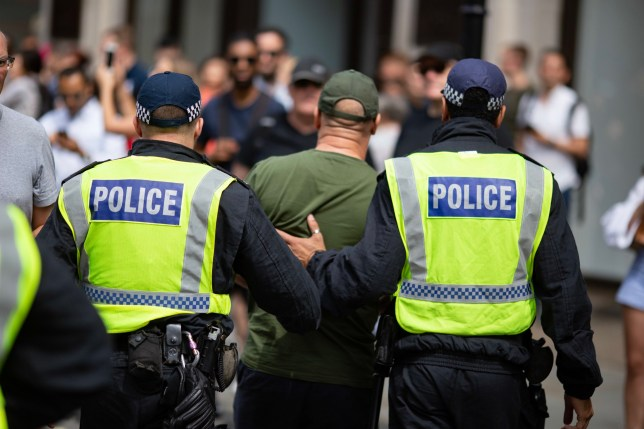LONDON, UNITED KINGDOM - 2019/08/03: Policemen arrest a 'Free Tommy' demonstrator during the protest. Free Tommy demonstrators took to the streets of London demanding the release of jailed far-right activist Tommy Robinson. Anti-Fascist demonstrators countered the protest, declaring that supporters of Tommy Robinson cant march unopposed. (Photo by Ryan Ashcroft/SOPA Images/LightRocket via Getty Images)