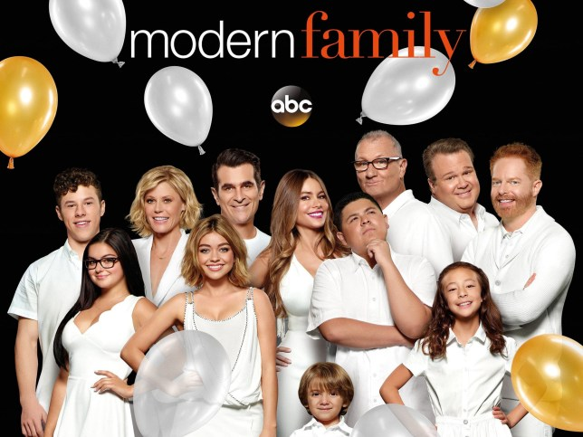 The entire cast of Modern family pose with balloons