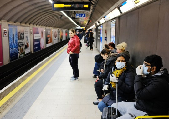 People wearing face masks in King's Cross tube station in London