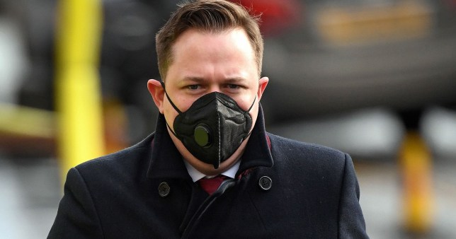 A commuter wears a face mask as a precaution, whilst walking in Edinburgh on March 18, 2020 as people take precautions amid the coronavirus outbreak. - The British government will on Wednesday unveil a raft of emergency powers to deal with the coronavirus epidemic, including proposals allowing police to detain potentially infected people to be tested. (Photo by ANDY BUCHANAN / AFP) (Photo by ANDY BUCHANAN/AFP via Getty Images)