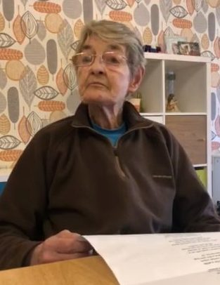 Video grab of Maggie Burns, 77, reading a Coronavirus poem, inspired by Rabbie Burns, at the Heatherfield Care Home in Armadale, West Lothian. See SWNS story SWSCpoem. This heartwarming video shows an elderly care home resident reading a poem about CORONAVIRUS - inspired by Rabbie Burns. Maggie Burns, 77, was filmed reading the poem, 'Tae a Virus' in a strong Scots accent, in the care home where she lives. A member of staff found the tongue-in-cheek poem on Facebook and it read it aloud to residents at at Heatherfield Care Home in Armadale, West Lothian. But Maggie corrected some of the pronunciations - so was asked to read it herself.