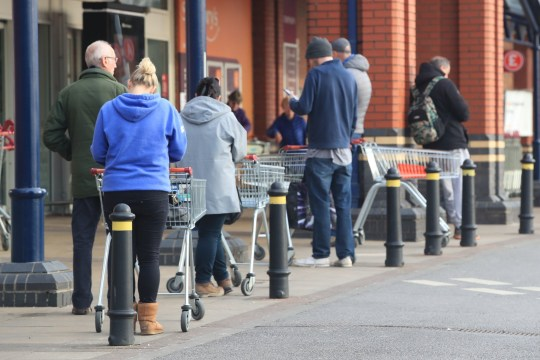 People queue at a Sainsbury's supermarket at Colton, on the outskirts of Leeds, the day after Prime Minister Boris Johnson put the UK in lockdown to help curb the spread of the coronavirus. PA Photo. Picture date: Tuesday March 24, 2020. See PA story HEALTH Coronavirus. Photo credit should read: Danny Lawson/PA Wire