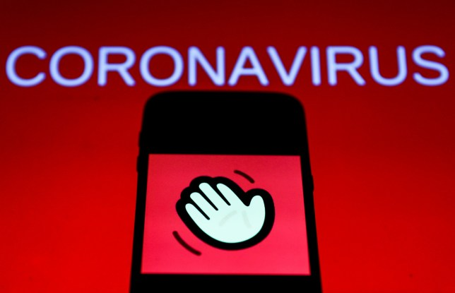 Houseparty app icon is seen displayed on phone screen with coronavirus sign in the background in this illustration photo taken in Poland on March 23, 2020. (Photo by Jakub Porzycki/NurPhoto)