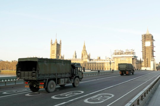 British Army lorries travelling across Westminster Bridge towards the Houses of Parliament