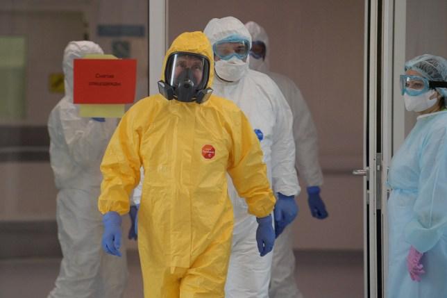 Russia's President Vladimir Putin wears a yellow protective suit against coronavirus