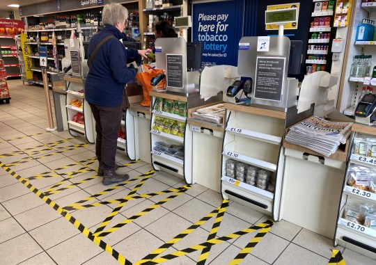 Taped-off areas for customers to distance themselves from each other are seen at the checkout area of a local Tesco store as the number of coronavirus disease cases (COVID-19) grow around the world, in London, Britain, March 21, 2020. REUTERS/Toby Melville