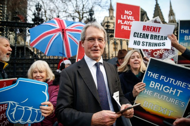 LONDON, ENGLAND - DECEMBER 20: Conservative politician (C) Owen Paterson and Andrea Jenkins (R) with Pro-Brexit campaigners celebrating near the Houses of Parliament on December 20, 2019 in London, England. The EU Withdrawal Agreement Bill passed implementing the prime minister's plan to leave the Union on 31 January. (Photo by Hollie Adams/Getty Images)