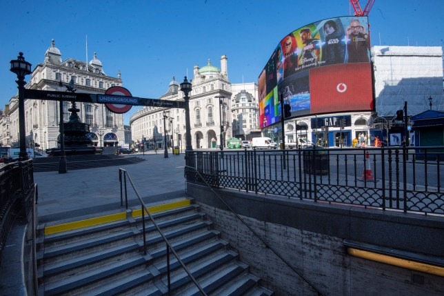a deserted picadilly circus tube station during rush hour