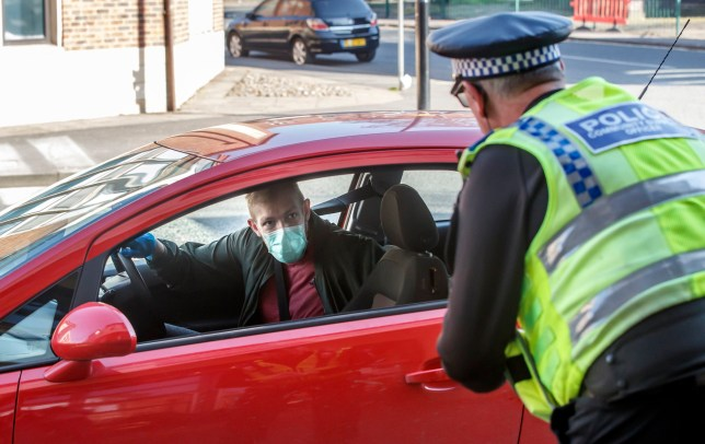 Police at a vehicle checkpoint in York where officers from North Yorkshire Police were ensuring that motorists and their passengers are complying with government restrictions and only making essential journeys, after Prime Minister Boris Johnson put the UK in lockdown to help curb the spread of the coronavirus. PA Photo. Picture date: Thursday March 26, 2020. See PA story HEALTH Coronavirus. Photo credit should read: Danny Lawson/PA Wire