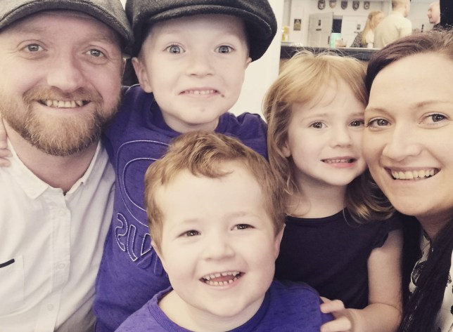 Jacob is one with flat cap on stood next to his dad, Darren. Jackson in front, Jessica, 3 with mum Sarah